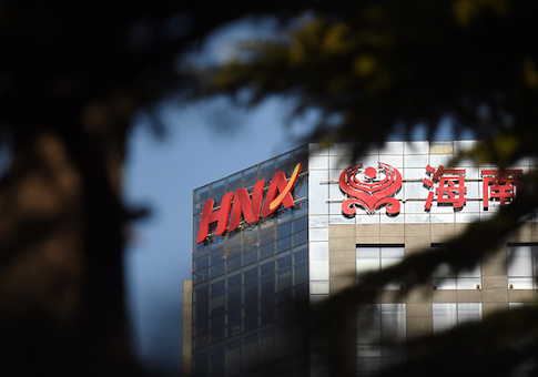 The HNA logo is seen on a building in Beijing